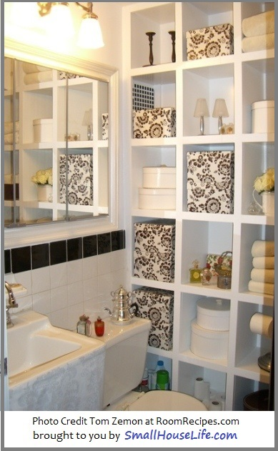 Small black and white bathroom with amazing storage idea. SmallHouseLife.com
