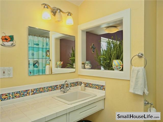Small Bath with white tile and yellow walls